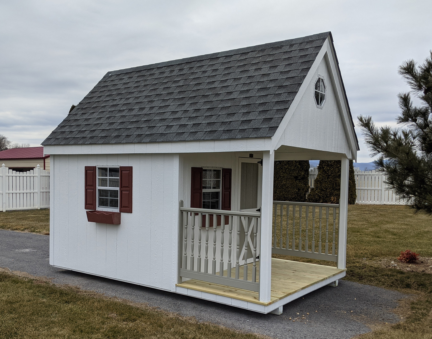 White shed with red trim